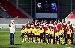 LLANELLI, WALES - Thursday, August 22, 2013: Wales players line up for a team group photograph before the Group A match against England of the UEFA Women's Under-19 Championship Wales 2013 tournament at Parc y Scarlets. (Pic by David Rawcliffe/Propaganda)