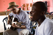 Member of the band King's Jubilee, Zaroe Amilcar (right), sings during a jamming session with Canadian artist Dave Bidini (left)  at the  Buduburam refugee settlement, roughly 20 km west of Ghana's capital Accra on Friday April 13, 2007. The group, which is composed of five Liberian men living at Buduburam, is currently recording their second album, and already has a growing number of fans back in Liberia. The Buduburam refugee settlement is still home over 30,000 Liberians, most of which have mixed feelings about returning to Liberia..