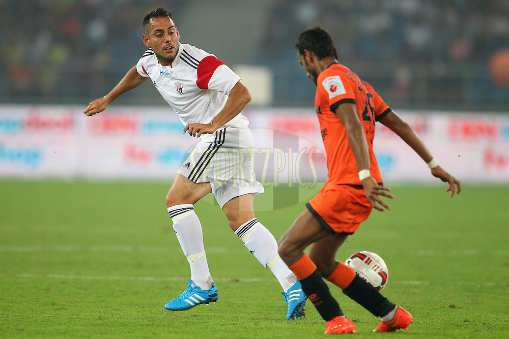 Leo Bertos of NorthEast United FC switches the ball during match 16 of the Hero Indian Super League between The Delhi Dynamos FC and NorthEast United FC held at the Jawaharlal Nehru Stadium, Delhi, India on the 29th October 2014.<br /> <br /> Photo by:  Ron Gaunt/ ISL/ SPORTZPICS
