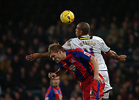 Photo: Kevin Poolman.<br />Crystal Palace v Colchester United. Coca Cola Championship. 09/12/2006. Colchester's Chris Iwelumo and Darren Ward of Palace both go up for a header.