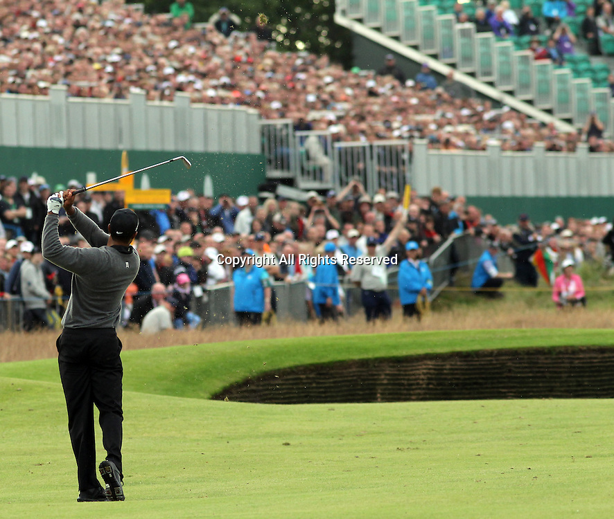 20.07.12 Lytham & St Annes, England. American Tiger Woods hits his approach to the 18th green during the second round of The Open Golf Championship from the Royal Lytham & St Annes course in Lancashire