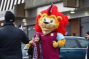 A young Aston Villa fan poses with the Villa Mascot during the EFL Sky Bet Championship match between Aston Villa and Burton Albion at Villa Park, Birmingham, England on 3 February 2018. Picture by John Potts.