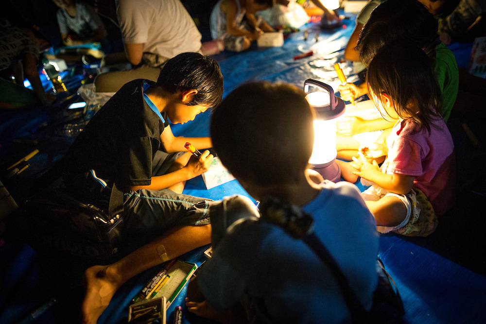 NAGASAKI, JAPAN - AUGUST 8 : People participate in making and writing message to the candle-lit paper lanterns at Nagasaki Peace Park on the eve ahead of the 71st anniversary activities, commemorating the atomic bombing of Nagasaki on August 8, 2016 in Nagasaki, southern Japan. On August 9, 1945, during World War II, the United States dropped the second Atomic bomb, a plutonium implosion-type bomb on Nagasaki city, killing an estimated 40,000 people which ended the World War II. (Photo by Richard Atrero de Guzman/NURPhoto)