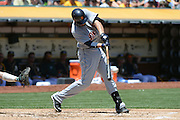 May 29, 2014; Oakland, CA, USA; Detroit Tigers third baseman Nick Castellanos (9) hits a single against the Oakland Athletics during the second inning at O.co Coliseum.
