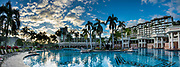 Kauai Marriott Resort swimming pool and palms at sunset. Nawiliwili Beach, Lihue, island of Kauai, Hawaii, USA. This image was stitched from multiple overlapping images. For this photo's licensing options, please inquire.