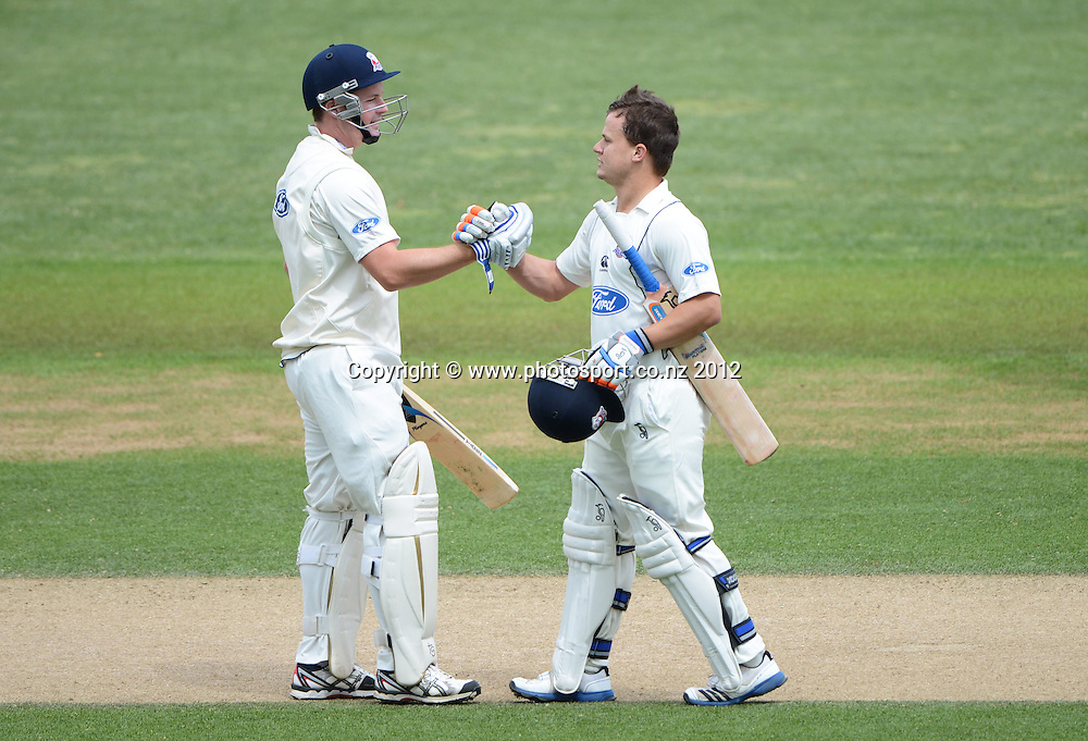 Auckland's Craig Cachopa celebrates his century with team mates Colin Munro (L). Plunket Shield Cricket, Auckland Aces v Wellington Firebirds at Eden Park Outer Oval. Auckland on Wednesday 28 November 2012. Photo: Andrew Cornaga/Photosport.co.nz