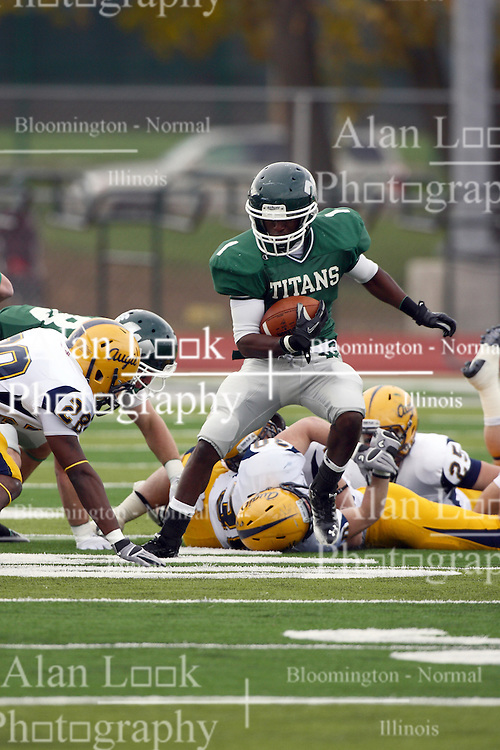 12 November 2011:  Cameron Allen cuts back to sidestep Mack Gray during an NCAA division 3 football game between the Augustana Vikings and the Illinois Wesleyan Titans in Tucci Stadium on Wilder Field, Bloomington IL