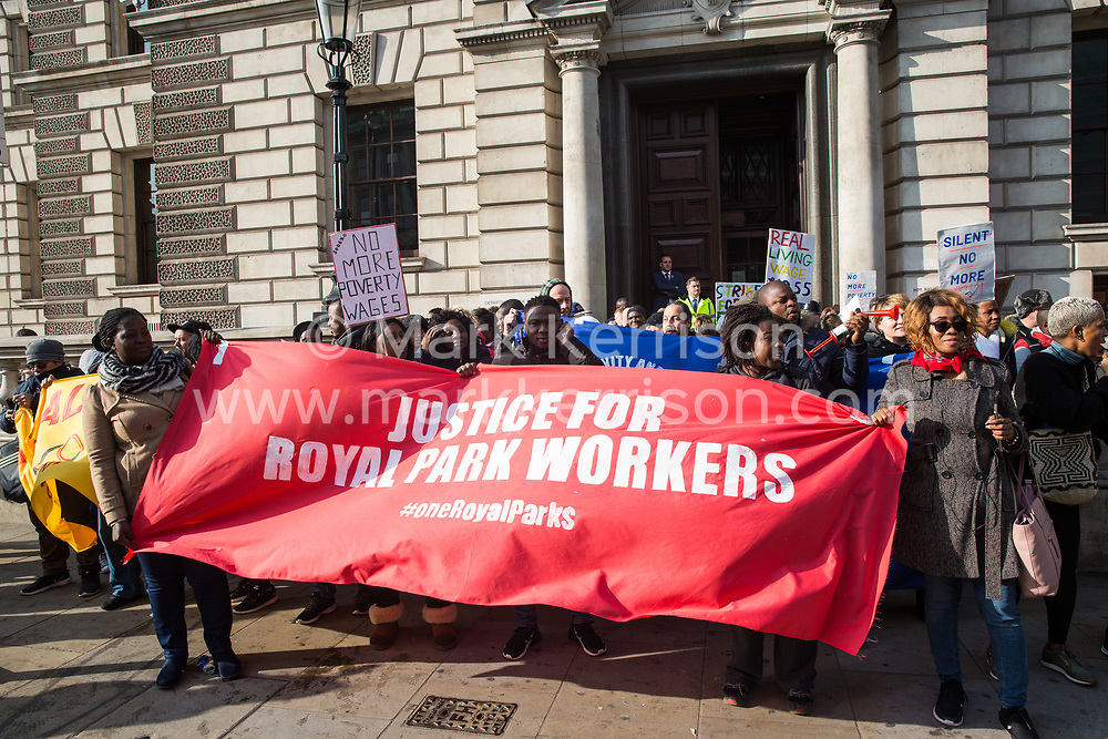 London, UK. 31 October, 2019. Low-paid migrant Ministry of Justice (MoJ) workers outsourced via OCS and belonging to the United Voices of the World (UVW) trade union stand outside the Department of Digital, Culture, Media and Sport during a coordinated series of 'five strikes in one day' involving also cleaners, caterers and porters from St Mary's Paddington, University of Greenwich café workers, cleaners from ITV and Channel 4's offices and park attendants from the Royal Parks. The MoJ workers are seeking the London Living Wage of £10.55 and parity of sick pay and annual leave with civil servants.
