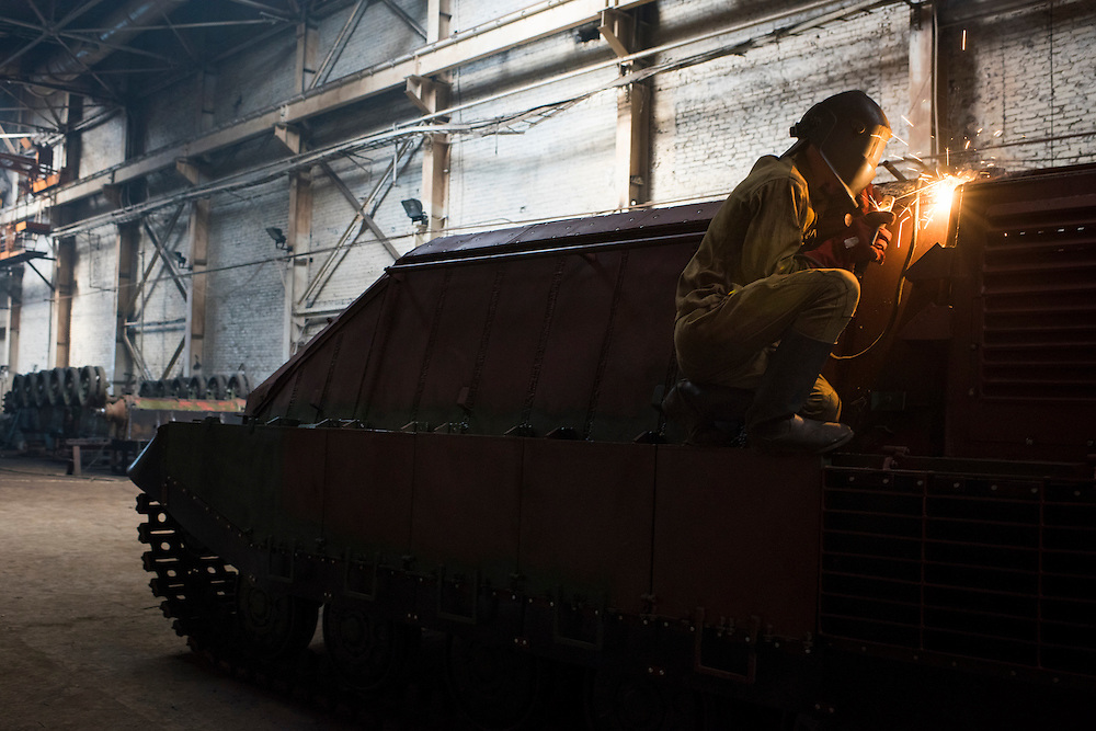 A member of Azov Engineering Group works to modify a vehicle being built on a tank chassis on September 9, 2015 in Kyiv, Ukraine.