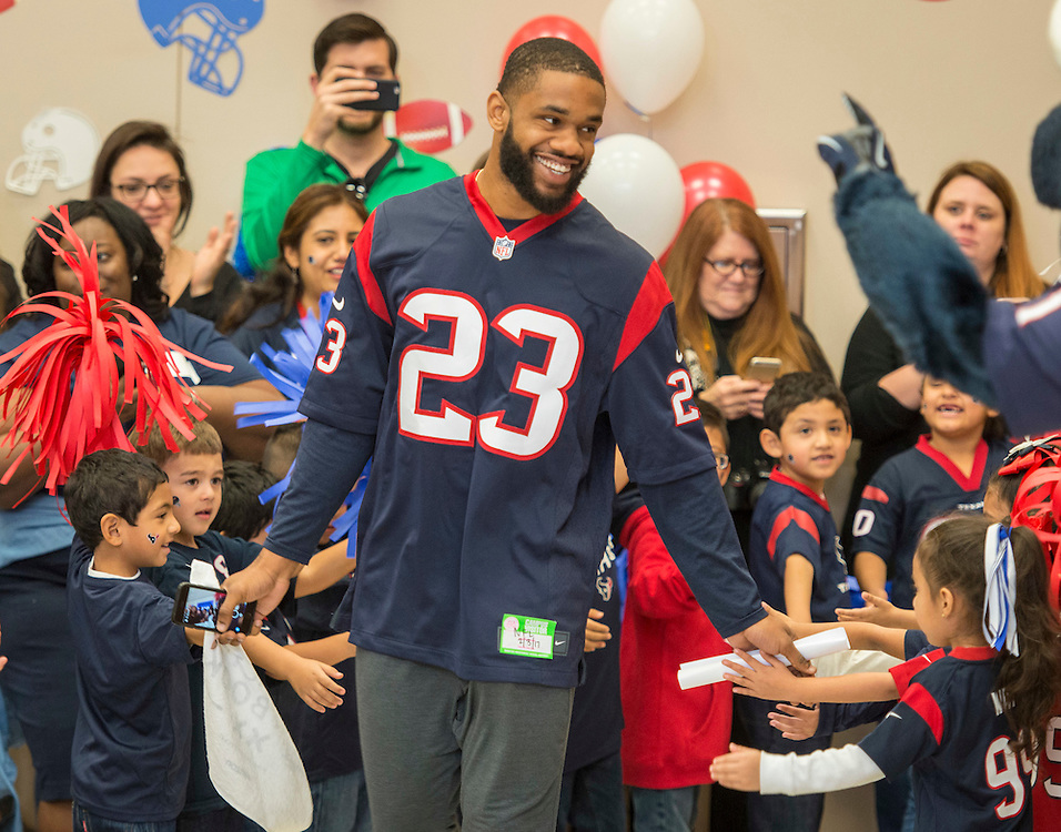Houston Texans safety Kurtis Drummond is greeted by students during the Houston launch of the Character Playbook, a joint initiative of the NFL and the United Way Worldwide at Pilgrim Academy, February 3, 2017.