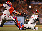 Philadelphia Phillies pitcher Ken Giles, right, and catcher Carlos Ruiz are unable to catch an infield fly ball hit by San Francisco Giants' Gregor Blanco during the eighth inning of a baseball game, Friday, August 15, 2014, in San Francisco. (AP Photo/Beck Diefenbach)