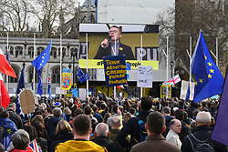 Put it to the People demonstration in central London against Brexit and an appeal for a Peoples Vote on a final Deal. Tom Watson MP speaking on big screen. London UK 23 March 2019