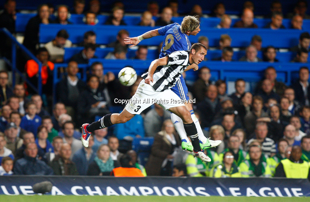 19.09.12 London, ENGLAND: <br /> Giorgio Chiellini of Juventus F.C. and Fernando Torres of Chelsea<br /> during the UEFA Champions League Group E match between Chelsea and  Juventus at Stamford Bridge Stadium