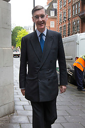 © Licensed to London News Pictures. 13/06/2019. London, UK. Jacob Rees-Mogg stands with Brexit protestor Stuart Holmes as he arrives at TV studios near Parliament. Later candidates for the leadership of the Conservative Party will face the first round of voting in Parliament Photo credit: George Cracknell/LNP