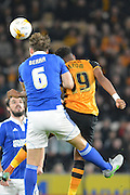 Christophe Berra of Ipswich Town and Hull City striker Chuba Akpom go for te ball during the Sky Bet Championship match between Hull City and Ipswich Town at the KC Stadium, Kingston upon Hull, England on 20 October 2015. Photo by Ian Lyall.