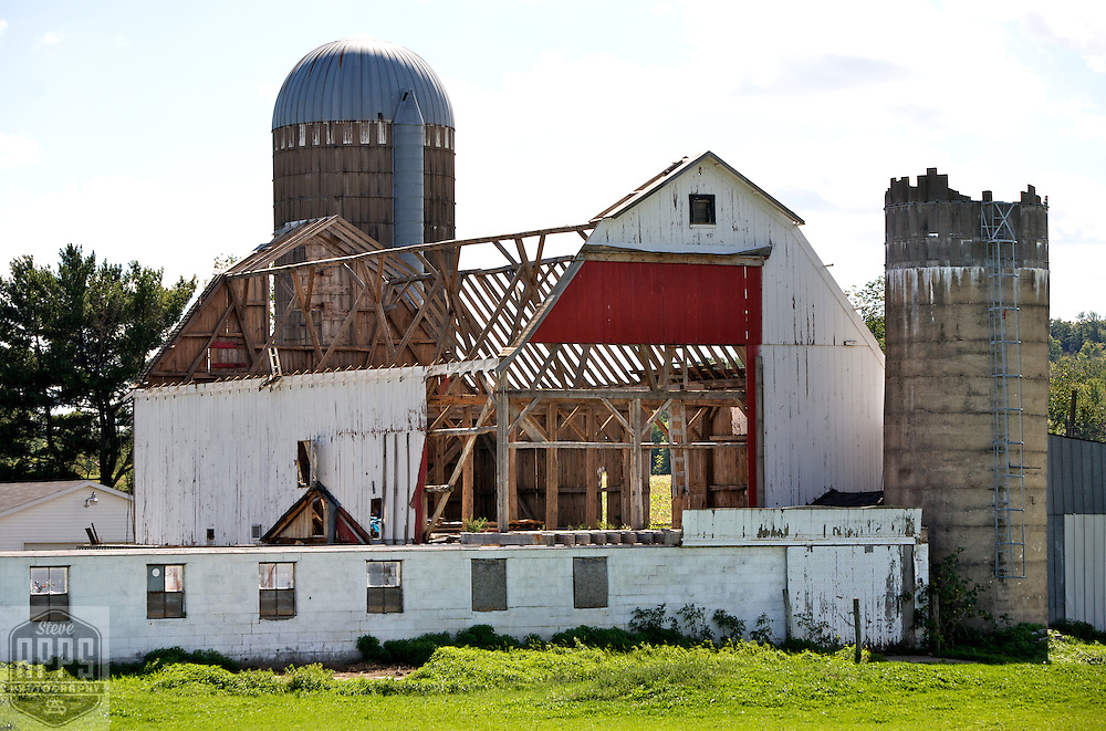 A collection of Barns that still can be seen while traveling the countryside in  the beautiful State of Wisconsin.<br /> Chippewa County- Hwy 64 and Hwy 53, exit 112. Barn being taken down. Barns from around the State of Wisconsin.
