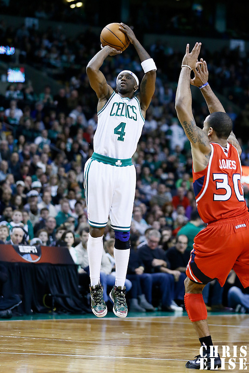 08 March 2013: Boston Celtics shooting guard Jason Terry (4) takes a jumpshot over Atlanta Hawks small forward Dahntay Jones (30) during the Boston Celtics 107-102 OT victory over the Atlanta Hawks at the TD Garden, Boston, Massachusetts, USA.