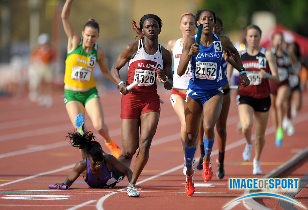 Mar 29, 2012; Austin, TX, USA; Danielle Burchett of Stephen A. Austin falls on the first leg of the womens 4 x 800m relay in the 85th Clyde Littlefield Texas Relays at Mike A. Myers Stadium. From left: Cate Westenhover of Baylor and Burchett and Shakerri Cole of Oklahoma and Shayla Wilson of Kansas and Courtney Moore of UT Arlington and Jessica Tonn of Stanford.