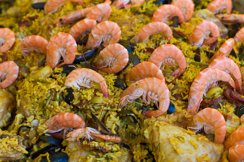 Fresh-cooked seafood and chicken Paella on sale at food market at La Reole in Bordeaux region of France