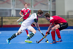 Surbiton's David Goodfield is tackled by Dan Fox of Holcombe. Holcombe v Surbiton - Semi-Final - Men's Hockey League Finals, Lee Valley Hockey & Tennis Centre, London, UK on 22 April 2017. Photo: Simon Parker