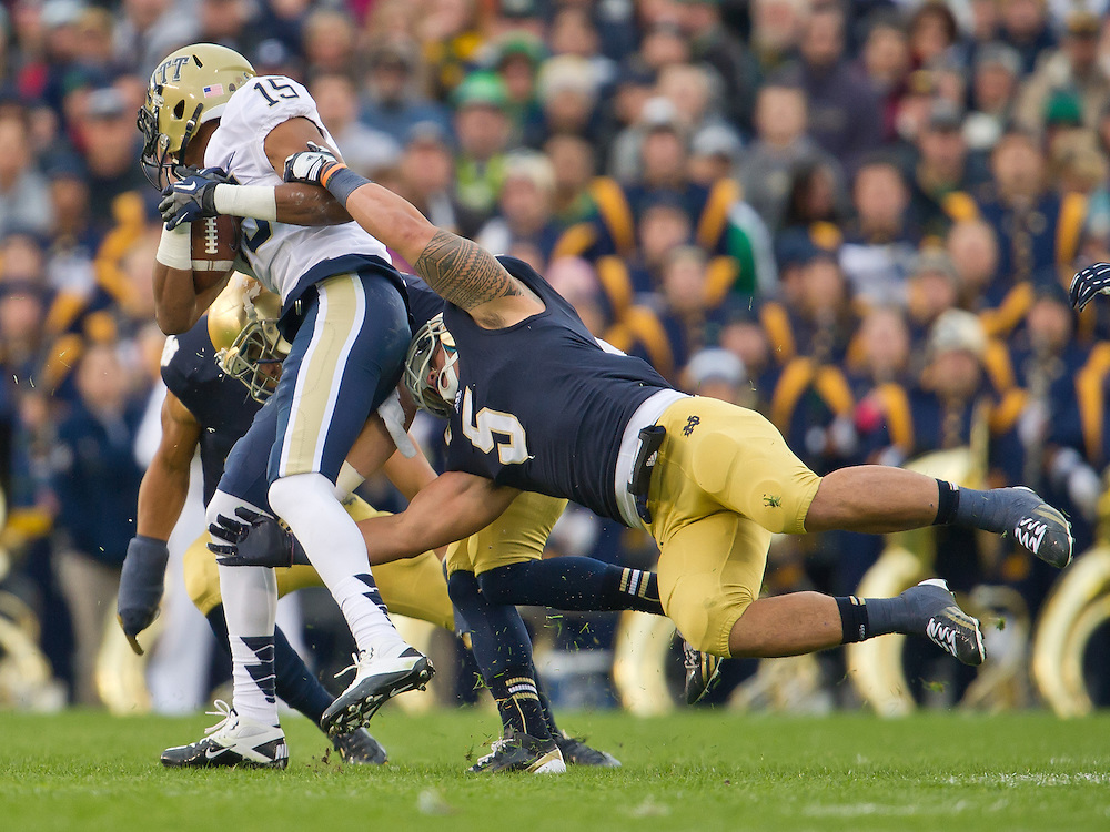 Linebacker Manti Te'o (5) tackles Pittsburgh Panthers wide receiver Devin Street (15) in the second quarter.