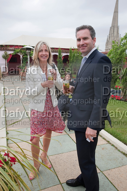 JANIE ROBERTSON; JAMES VAUGHAN, Archant Summer party. Kensington Roof Gardens. London. 7 July 2010. -DO NOT ARCHIVE-© Copyright Photograph by Dafydd Jones. 248 Clapham Rd. London SW9 0PZ. Tel 0207 820 0771. www.dafjones.com.