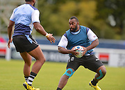 Peni Ravai avoids a tackle during the Fiji Training Session in preparation for the Rugby World Cup at London Irish RFC, Sunbury-On-Thames, United Kingdom on 14 September 2015. Photo by Ian Muir. during the Fiji Training Session in preparation for the Rugby World Cup at London Irish RFC, Sunbury-On-Thames, United Kingdom on 14 September 2015. Photo by Ian Muir.