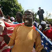Kenyans celebrate after Barack Obama is announced president at the Obama family homestead in Western Kenya. Kenyan relatives reside, November 5, 2008. Photo by Evelyn Hockstein for The New York Times.