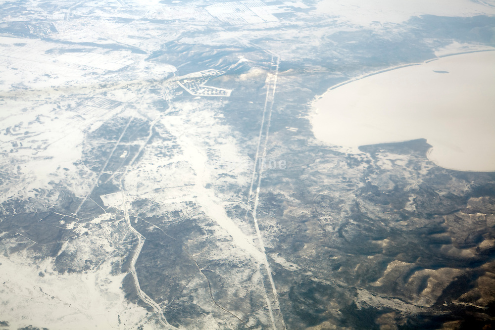 view from passenger airplane flying over Siberia