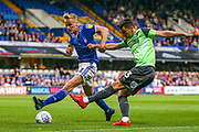 AFC Wimbledon midfielder Callum Reilly (33) shoots past Ipswich Town midfielder Flynn Downes (21) during the EFL Sky Bet League 1 match between Ipswich Town and AFC Wimbledon at Portman Road, Ipswich, England on 20 August 2019.