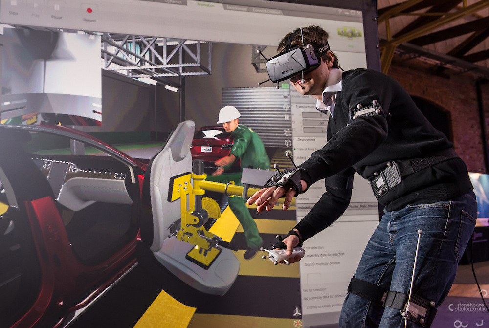 Application Engineer Joss Petit demonstrates Simulation tools for Rapid Innovation in Vehicle Engineering (STRIVE) at their exhibition stand at the Engineering Simulation Show, The Roundhouse, Derby, United Kingdom<br />