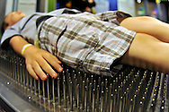 Downtown Charlotte science museum Discovery Place, new hands-on and marine exhibits opened summer 2010. This is a bed of nails in the new Cool Stuff exhibit
