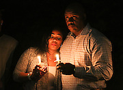 Donna, left, and Paul Sampleton Sr. embrace during the candlelight prayer service of the annual homicide victims vigil hosted by the Gwinnett County District Attorney's Office Victim Witness Program at the Gwinnett Justice and Administration Center in Lawrenceville. (Staff Photo: David Welker)