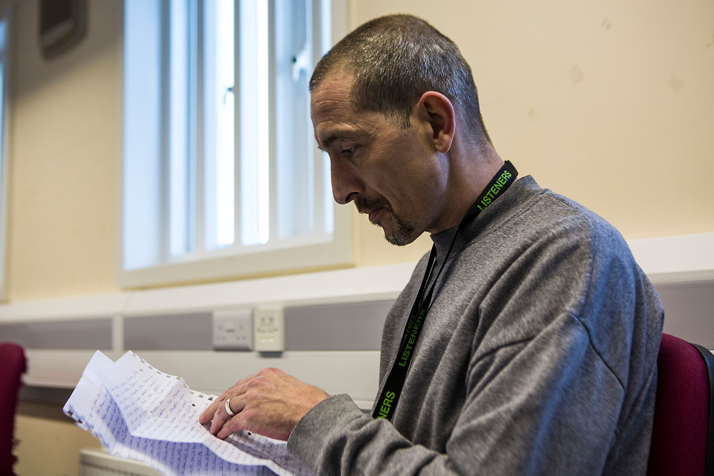 A prisoner reading a letter from a loved one. HMP/YOI Portland, Dorset. A resettlement prison with a capacity for 530 prisoners.  Portland, Dorset, United Kingdom.