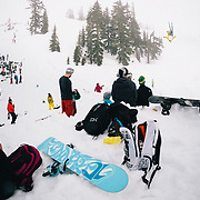 Pat Tolton inverted with a crowd of onlookers at the Mount Baker Sesh Up in the backcountry near Mount Baker Ski Area
