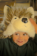 Eighteen month old Ali delights in wearing wolf head piece.