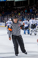 KELOWNA, CANADA - OCTOBER 5: Referee Chris Crich, exits the ice at the end of the game between the Kelowna Rockets and the Victoria Royals  on October 5, 2018 at Prospera Place in Kelowna, British Columbia, Canada.  (Photo by Marissa Baecker/Shoot the Breeze)  *** Local Caption ***