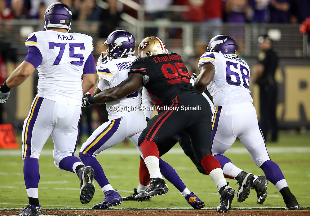 Minnesota Vikings quarterback Teddy Bridgewater (5) gets sacked by San Francisco 49ers defensive tackle Tank Carradine (95) during the 2015 NFL week 1 regular season football game against the San Francisco 49ers on Monday, Sept. 14, 2015 in Santa Clara, Calif. The 49ers won the game 20-3. (©Paul Anthony Spinelli)
