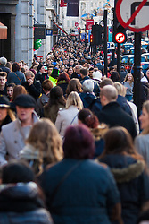 "London, December 20th 2014. Tens of thousands of shoppers descend on central London to scoop up pre-Christmas bargains as retailers offer discount incentives on ""Panic Saturday"". PICTURED: Crowds pack Regents Street."
