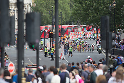 Th peloton approaches one of the feed zones during the Prudential RideLondon Classique, a 66 km road race in London on July 30, 2016 in the United Kingdom.