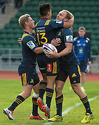 Highlanders player MATT FADDES (R) celebrates scoring a try with team mates JOSH RENTON (L) and JASON EMERY (c) the Natixis Cup rugby match between French team Racing 92 and New Zealand team Otago Highlanders at Sui San Wan Stadium in Hong Kong
