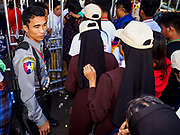 30 NOVEMBER 2017 - YANGON, MYANMAR: Myanmar police check the credentials of people going into the cathedral before the Papal Mass at St. Mary's Cathedral in Yangon. Thursday's mass was his last public appearance in Myanmar. From Myanmar the Pope went on to neighboring Bangladesh.    PHOTO BY JACK KURTZ