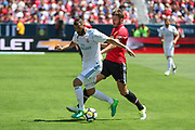 Manchester United Midfielder Michael Carrick tackles Real Madrid Forward Karim Benzema during the AON Tour 2017 match between Real Madrid and Manchester United at the Levi's Stadium, Santa Clara, USA on 23 July 2017.