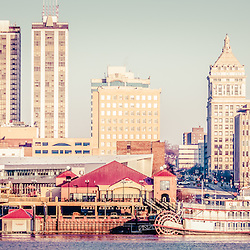 Peoria Illinois skyline retro panorama photo with downtown city buildings along the Illinois River. Picture has a retro vintage 1960s tone. Panoramic ratio is 1:3.