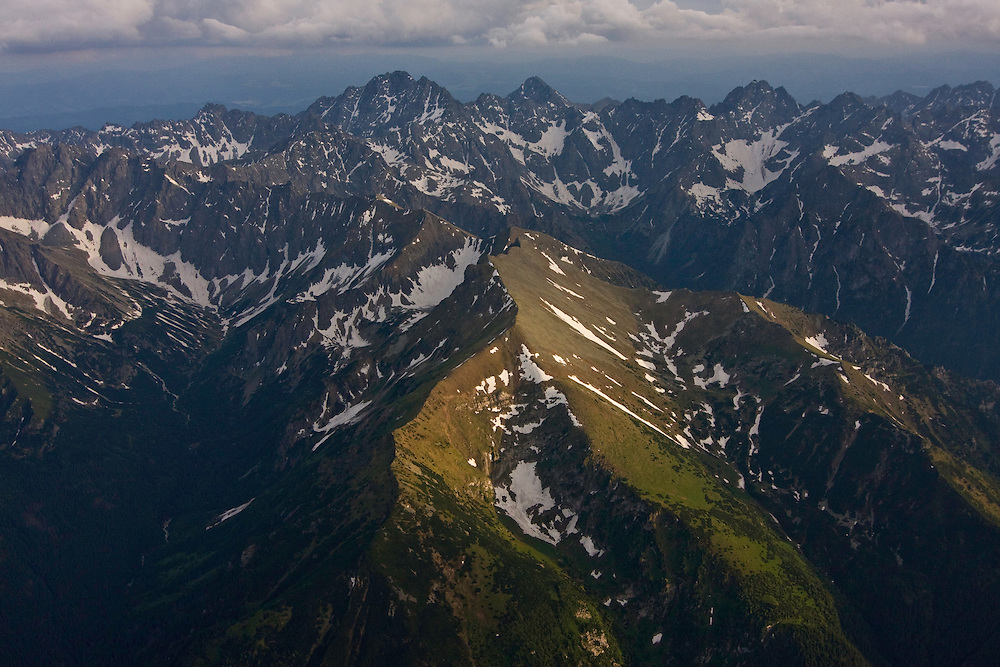 Aerial view of the northern side of the High Tatras, with mount Gerlach (2665m asl). On the background the Low Tatras. High Tatras, Slovakia. June 2009. Mission: Ticha