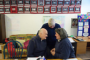 Windsor, Canada, 2014. Howard Pawley, former premier of Manitoba, Victoria Cross, a lawyer and Angela Fitzpatrick, a woman who is the subject of a city tax matter, discuss a point at a Property Tax Arrears Citizen's Committee meeting at Windsor Workers' Action Centre.