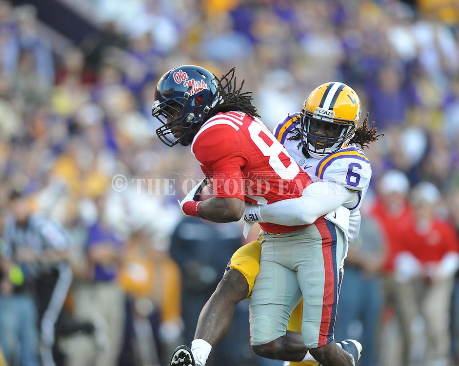 Ole Miss wide receiver Ja-Mes Logan (85) vs. LSU safety Craig Loston (6) at Tiger Stadium in Baton Rouge, La. on Saturday, November 17, 2012. LSU won 41-35.....