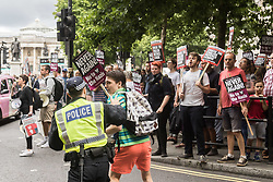 London, June 24th 2017. Anti-fascist protesters counter demonstrate against a march to Parliament by the far right anti-Islamist English Defence League. PICTURED: A police officer pushes an anti-fascist away from a small group of EDL supporters following a clash near Trafalgar Square.