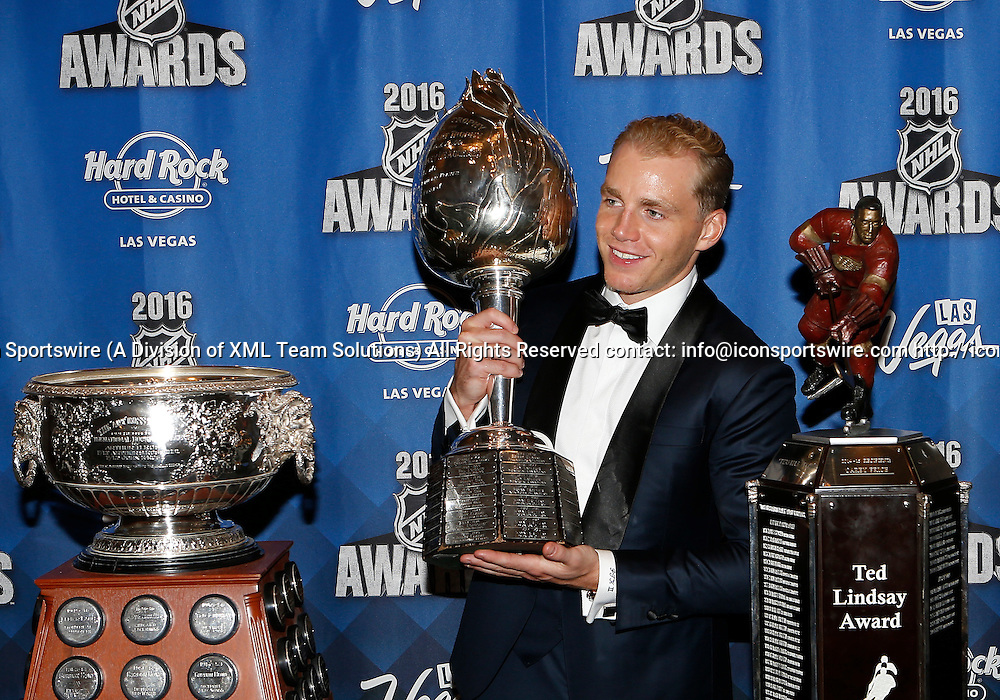 2016 June 22: Chicago Blackhawks right winger Patrick Kane poses for a photograph after receiving the Art Ross Trophy, the Hart Trophy, and the Ted Lindsay Award during the 2016 NHL Awards at the Hard Rock Hotel and Casino in Las Vegas, Nevada. (Photo by Marc Sanchez/Icon Sportswire)