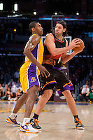 12 February 2013: Forward (15) Metta World Peace of the Los Angeles Lakers guards (14) Luis Scola of the Phoenix Suns during the first half of the Lakers 91-85 victory over the Suns at the STAPLES Center in Los Angeles, CA.